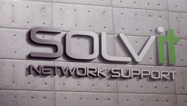 Solvit IT Canberra logo on a concrete wall